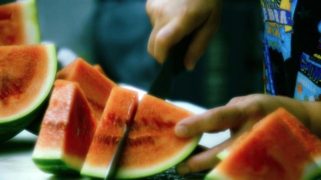 Cutting Watermelon, by Darren M Jorgensen